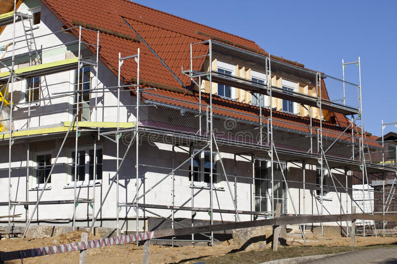 House under construction. With scaffold stock photo