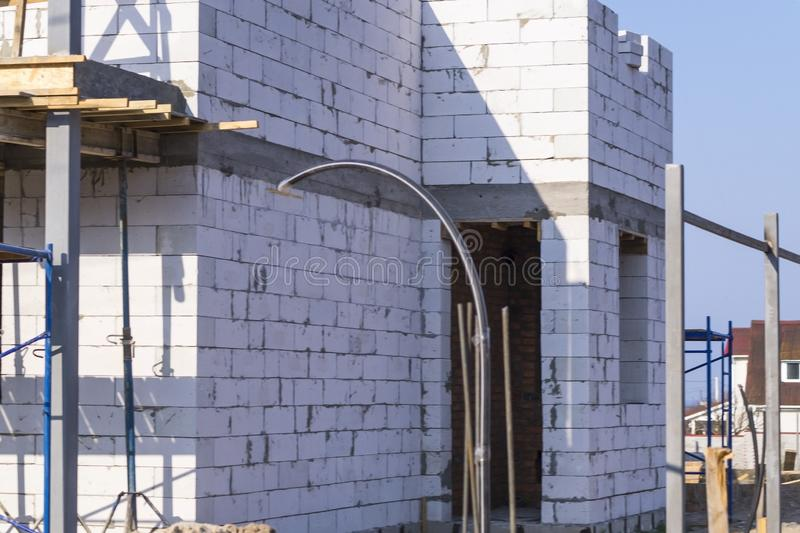 House under construction with white bricks royalty free stock photos
