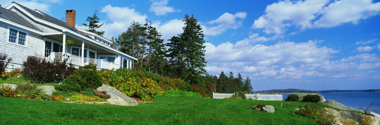 House with a view overlooking Spruce Head Harbor royalty free stock photography