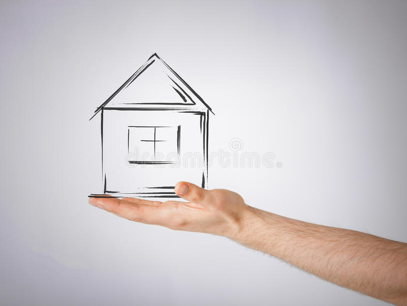 House on virtual screen in man hand. Real estate, technology and accomodation concept - picture of house on virtual screen in man hand stock images