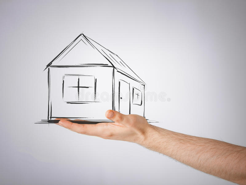 House on virtual screen in man hand. Real estate, technology and accomodation concept - picture of house on virtual screen in man hand royalty free stock photo