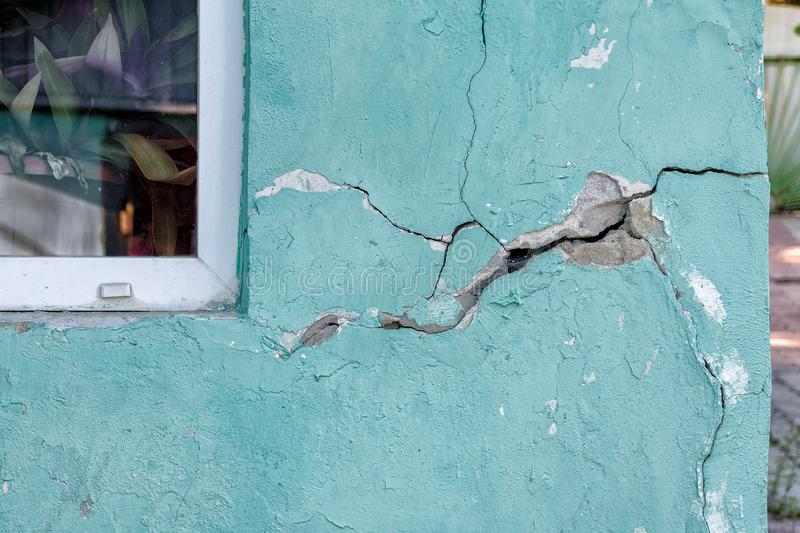 House wall with a crack, destroying the house royalty free stock image