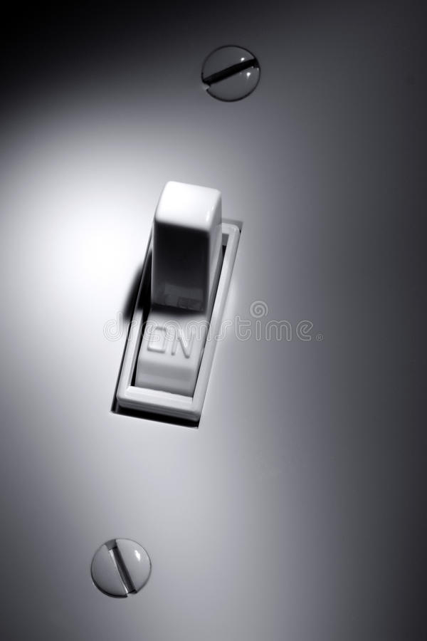 House Wall Electric Light Switch in ON Position royalty free stock photo