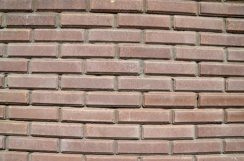 House wall element from a brick. House wall element from a brown brick stock photo