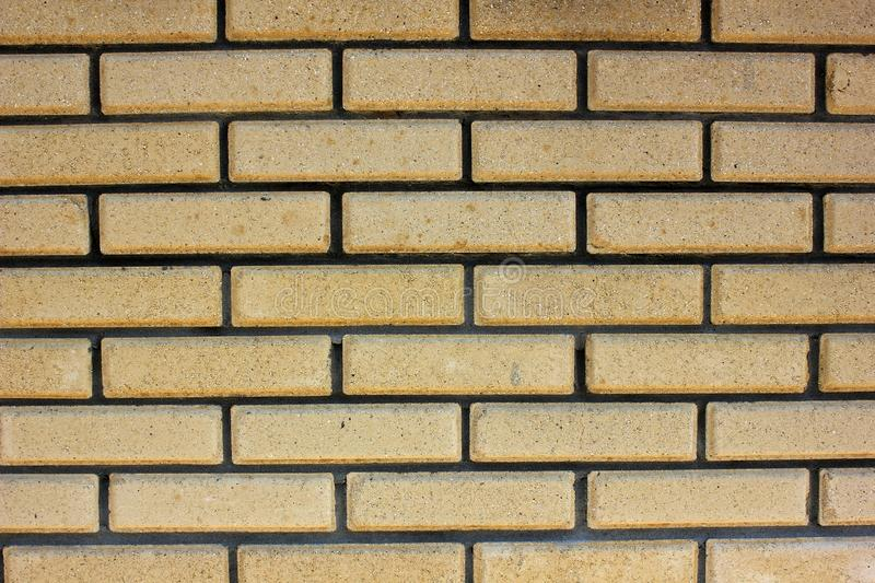 House wall element from a brick. House wall element from a yellow brick stock photography