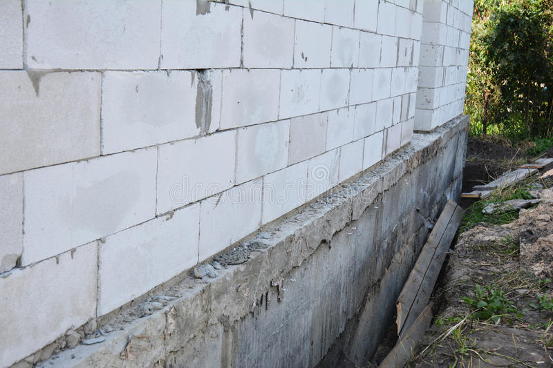House wall ready for waterproofing foundation with - Exterior foundation insulation panels ...