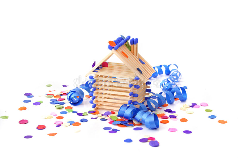 House-warming Party. Tinkered house within confetti and streamers. All isolated on white background royalty free stock photo