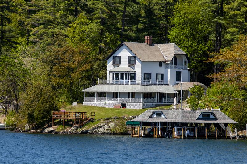 House on the water in Lake George. A house by the water in Lake George New York royalty free stock photography