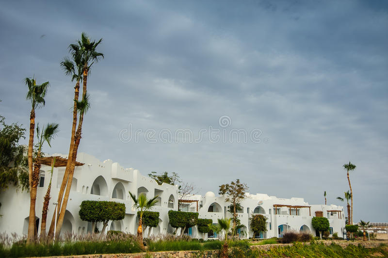 House. White house red sea in tropical resort whith palm and sand stock image