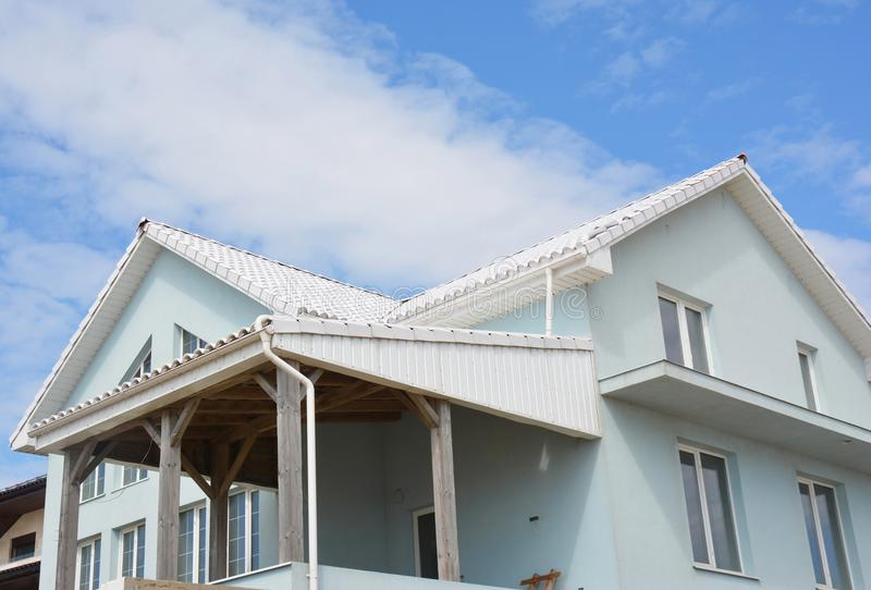 House with white roof tiles for energy saving. White roof bring cool savings and can reduce air conditioning. Costs by up to 20 percent royalty free stock photography