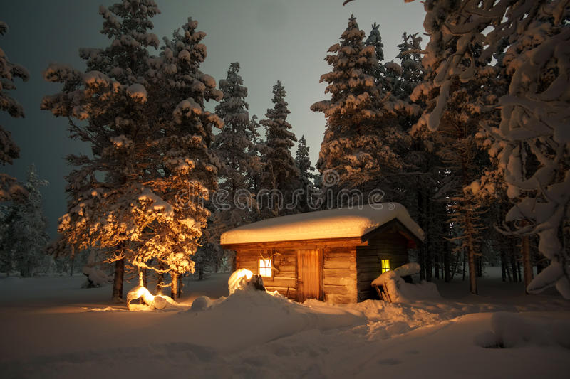 House in the winter forest royalty free stock images