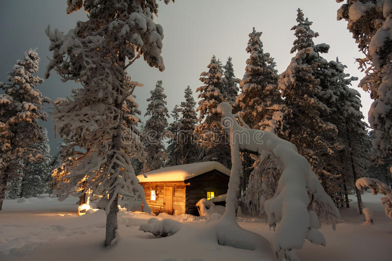 House in the winter forest royalty free stock photography