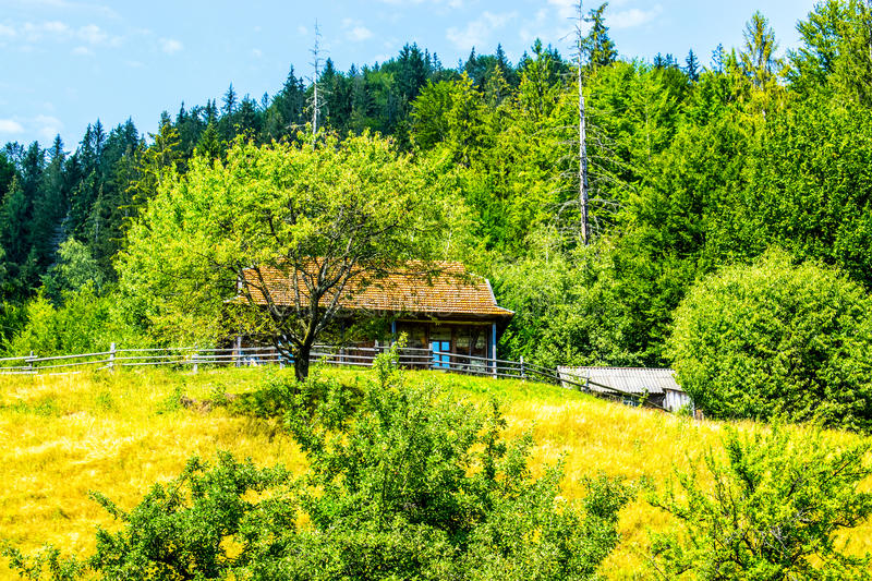 House by a wooden fence royalty free stock photos