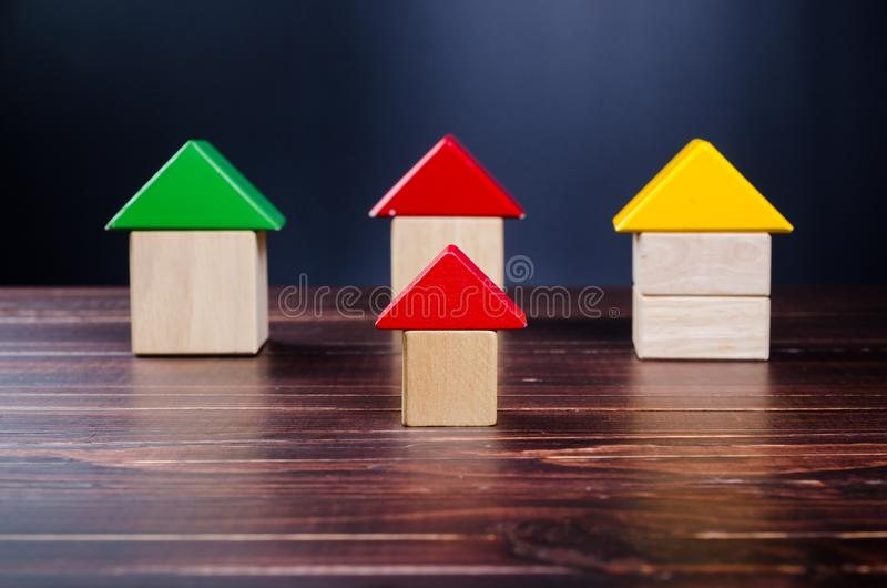 House from wooden toy blocks. On wooden board background,concept image stock image