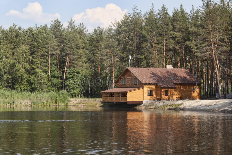 Download House In The Woods Above Lake Stock Photo
