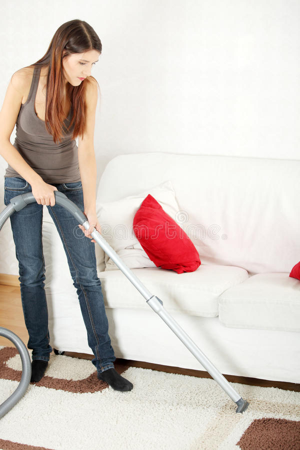 House work. Young beautiful woman with vacuum cleanerat home. Housework concept royalty free stock photo