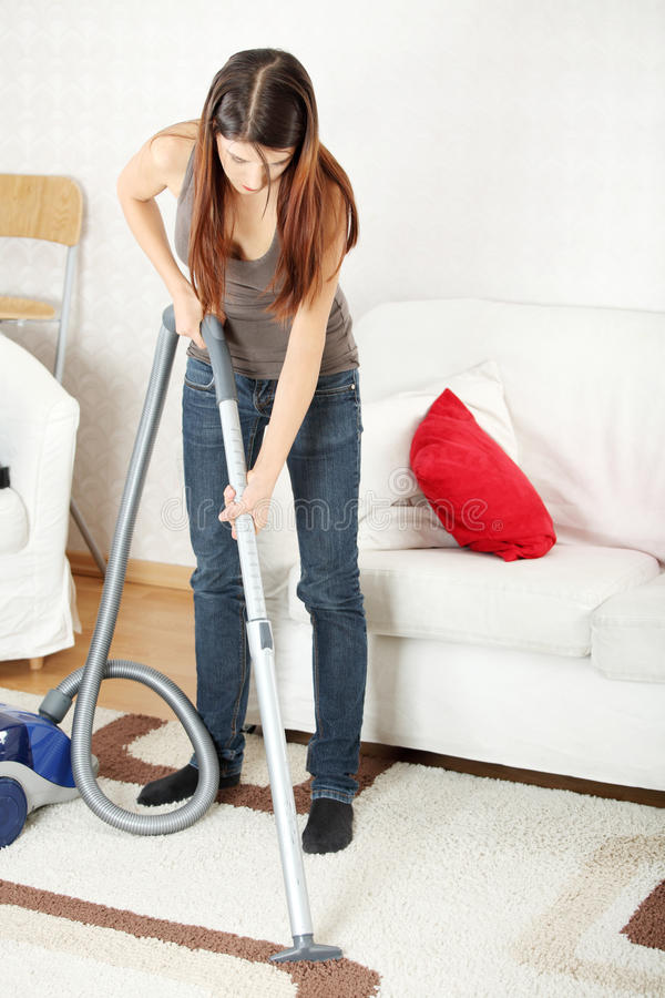 House work. Young beautiful woman with vacuum cleanerat home. Housework concept royalty free stock images
