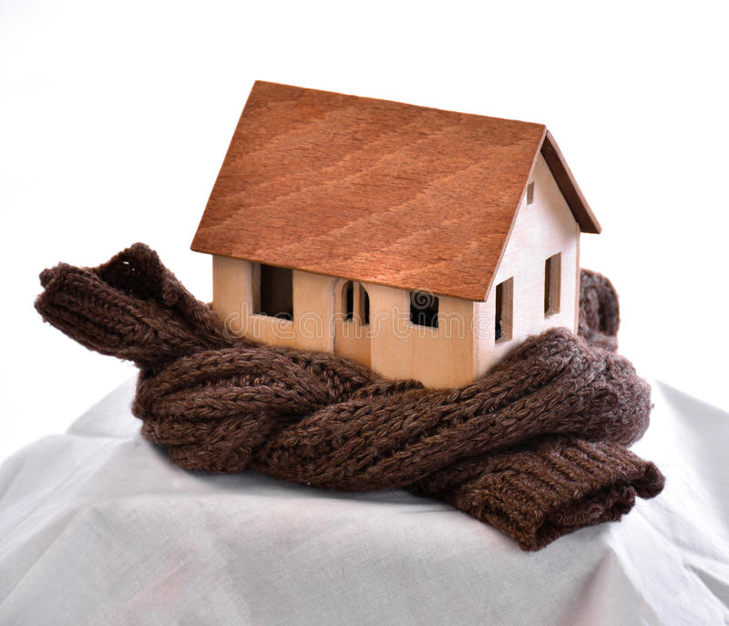 House wrapped in a scarf. Thermal insulation concept. House wrapped in a scarf isolated on white stock photos