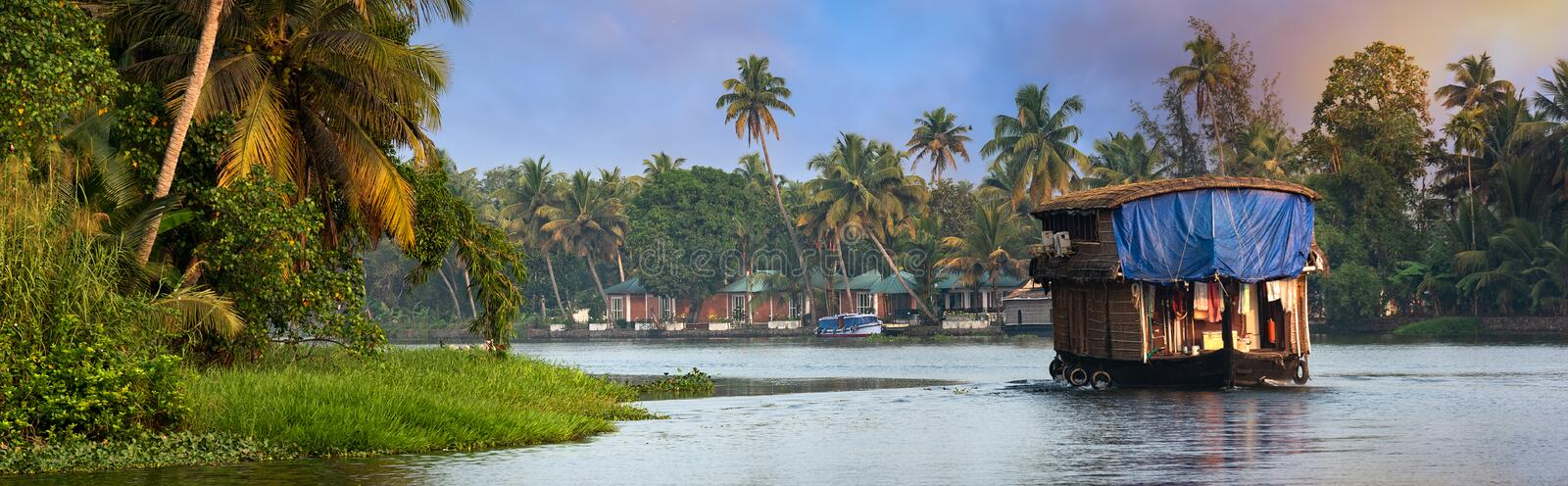Houseboat in Kerala, India. A traditional house boat is anchored on the shores of a fishing lake in Kerala`s Backwaters, Kerala, India stock photography