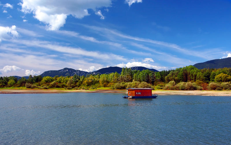 Houseboat And Mountains In Summer Royalty Free Stock Images