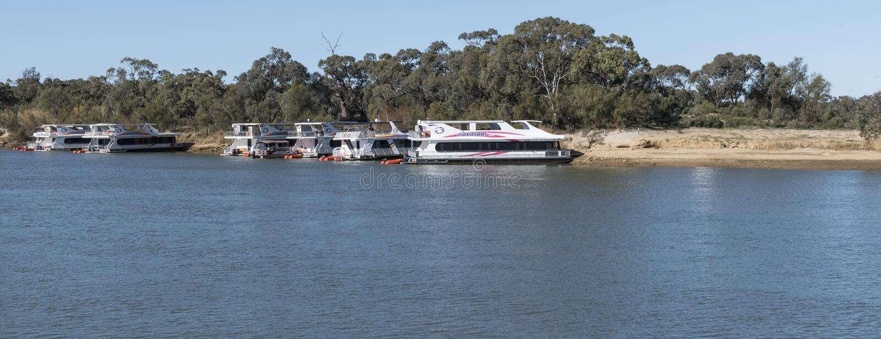 Houseboats, Murray river, Mildura, Australia. Houseboats moored on the banks of the peaceful Murray, Mildura, Australia royalty free stock photography