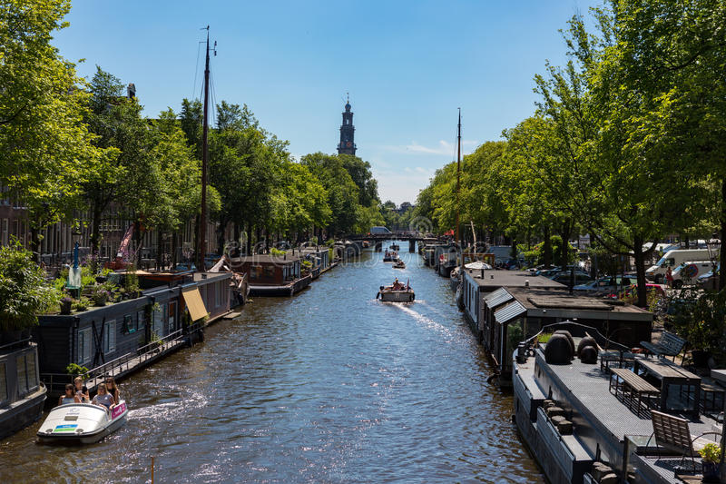 Houseboats at the Prinsengracht. Houseboats at the Amsterdam Prinsengracht in the Netherlands stock images