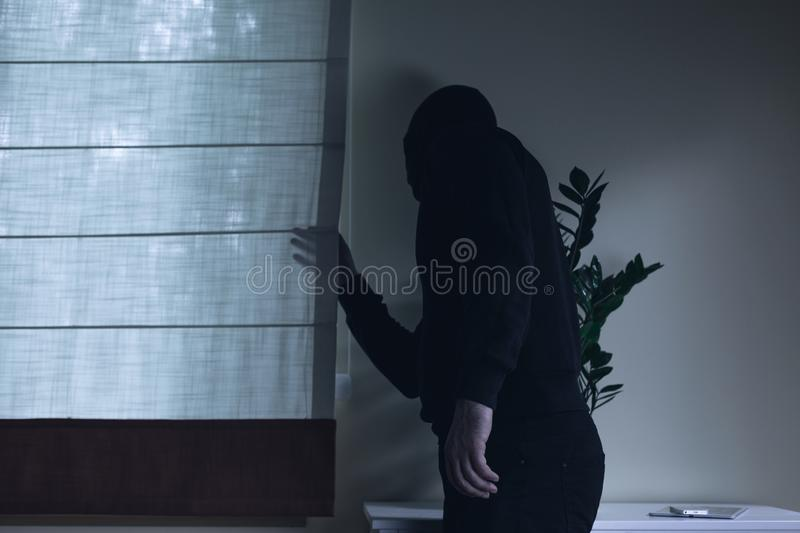 Housebreaker during night home invasion royalty free stock photo