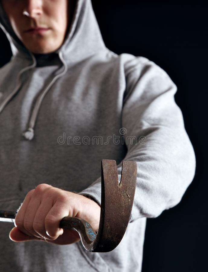 Housebreaker que faz seu crime foto de stock