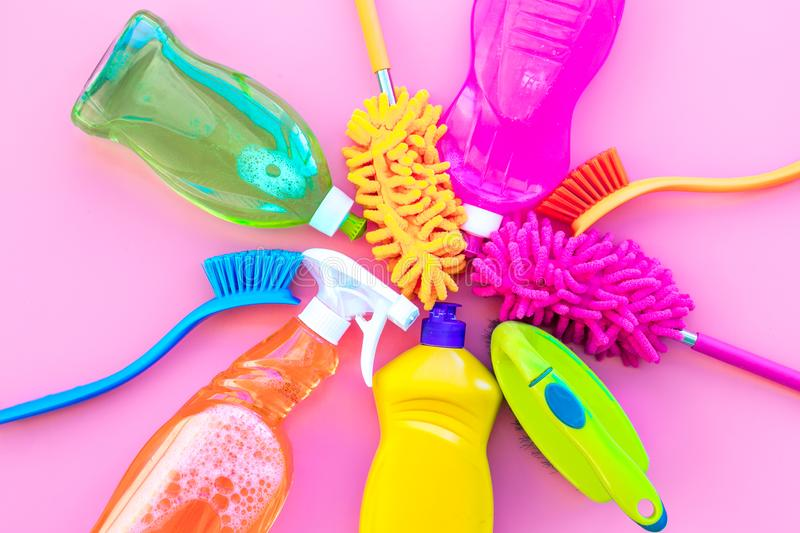 Housecleaning with detergents, soap, cleaners and brush in plastic bottles on pink background top view mockup stock image