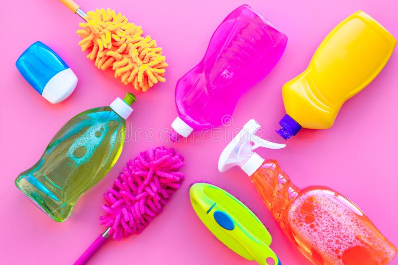 Housecleaning with detergents, soap, cleaners and brush in plastic bottles on pink background top view mockup stock photos