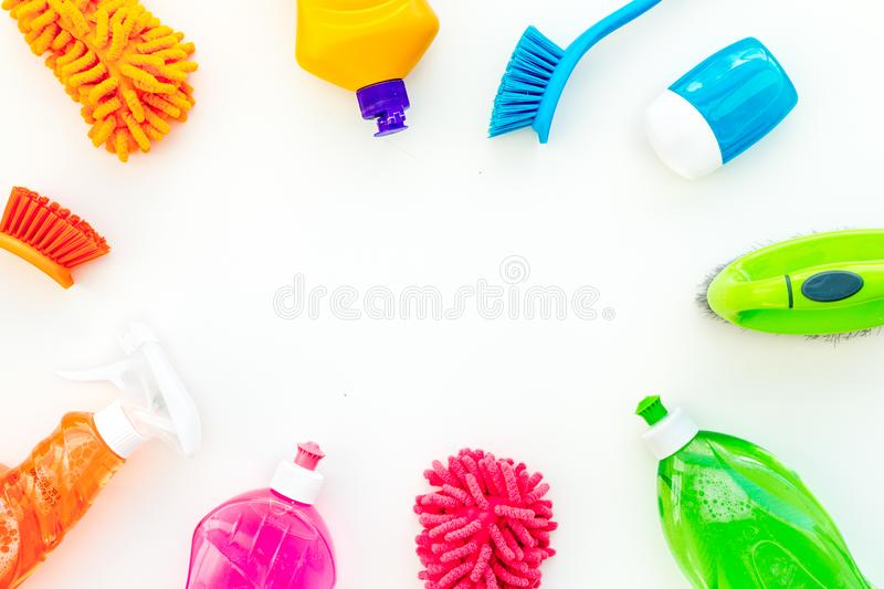 Housecleaning with detergents, soap, cleaners and brush in plastic bottles on white background top view mockup stock images