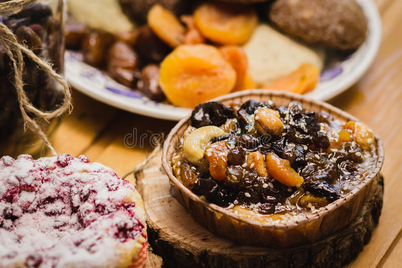 Household biscuits with cherries, nuts and dried fruits stock photos