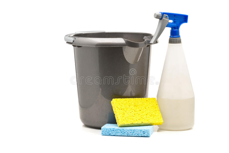 Household cleaning products - spray bottle, bucket and sponges stock photos