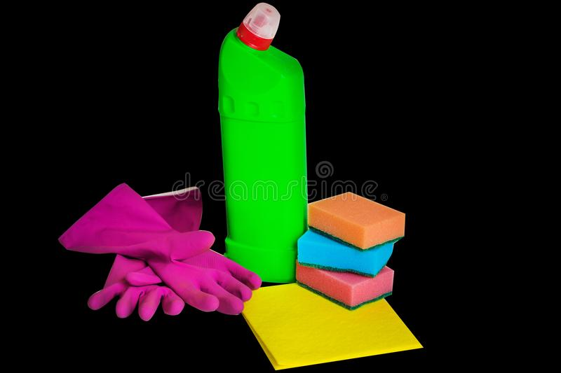 Composition of colorful cleaning supplies isolated on the black background royalty free stock image