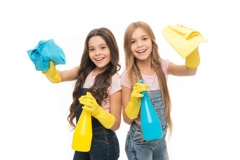 Household duties. Little helper. Girls cute kids love cleaning around. Keep it clean. Lets start cleaning. Kids cleaning. Together. Girls with yellow rubber royalty free stock photography