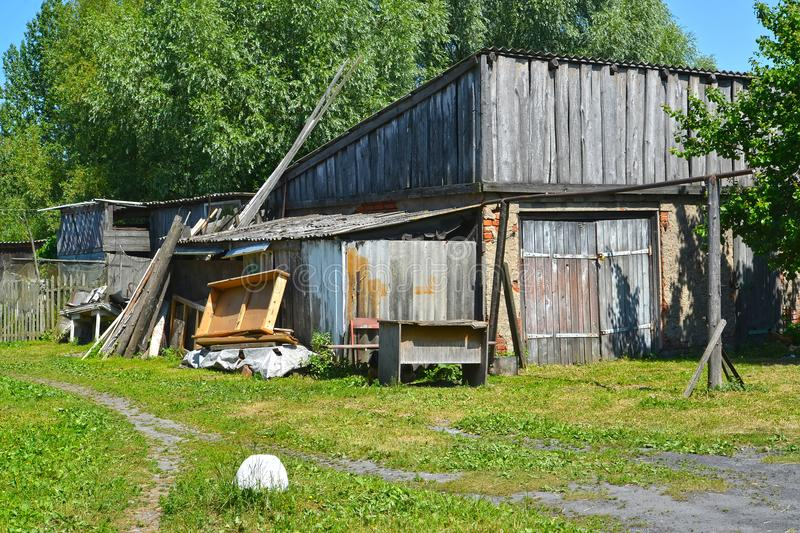 The household garbage lies about the old wooden shed. Polessk, Kaliningrad region royalty free stock photos