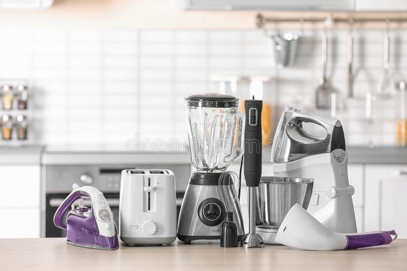 Household and kitchen appliances. On table against blurred background royalty free stock photography