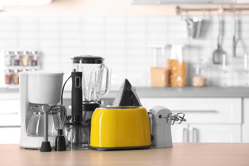 Household and kitchen appliances on table stock photo