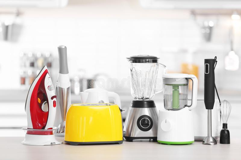 Household and kitchen appliances on table indoors. Interior element royalty free stock images