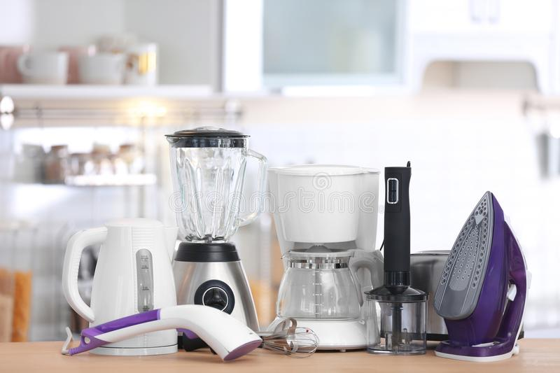 Household and kitchen appliances on table indoors stock photo