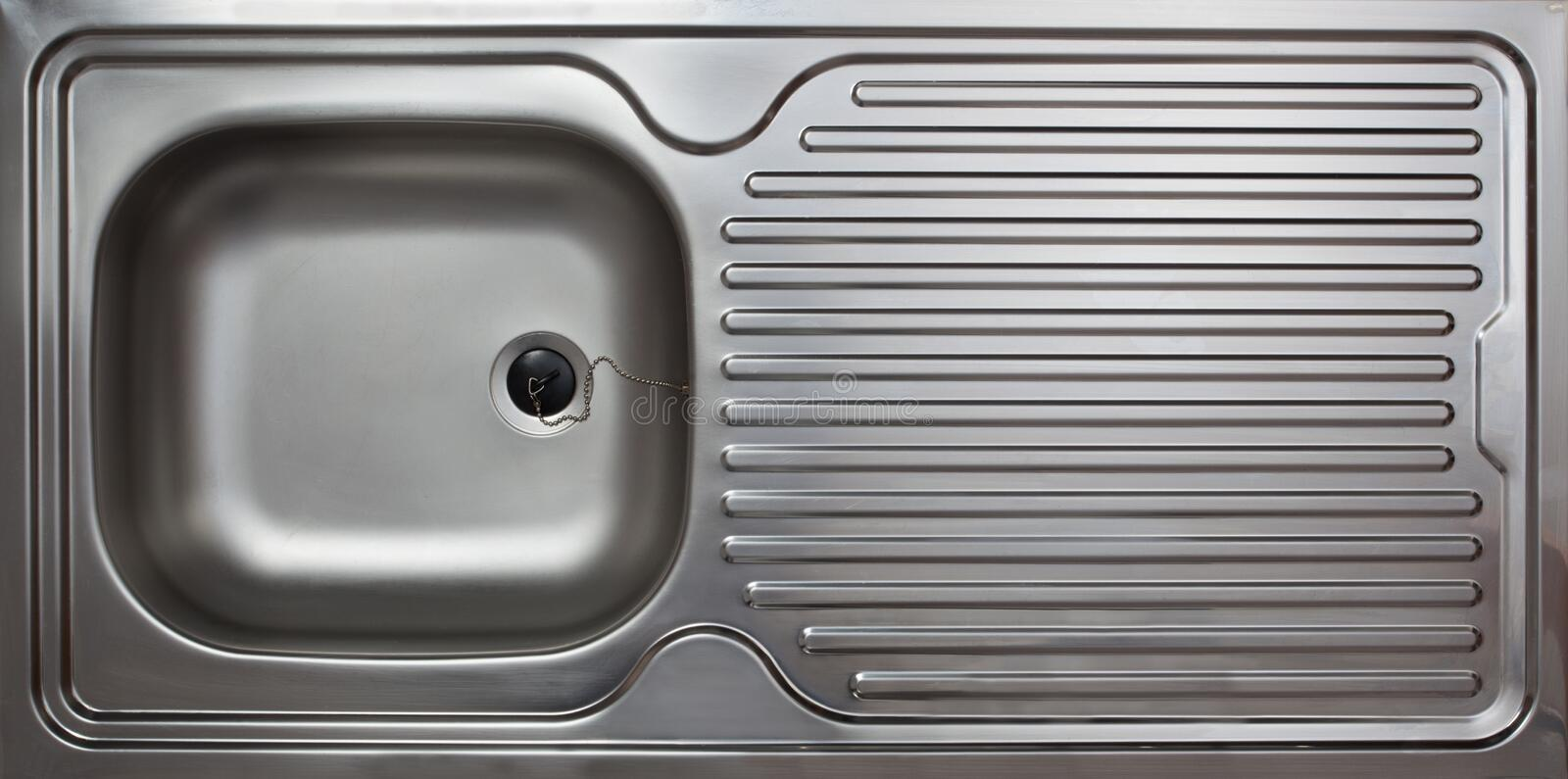 Household kitchen sink, steel. Kitchen sink made from polished steel as commonly used in private household stock photography