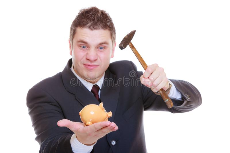 Man trying to break piggy bank with hammer. Household savings concept. Man wearing tuxedo trying to break piggy bank with hammer stock photos