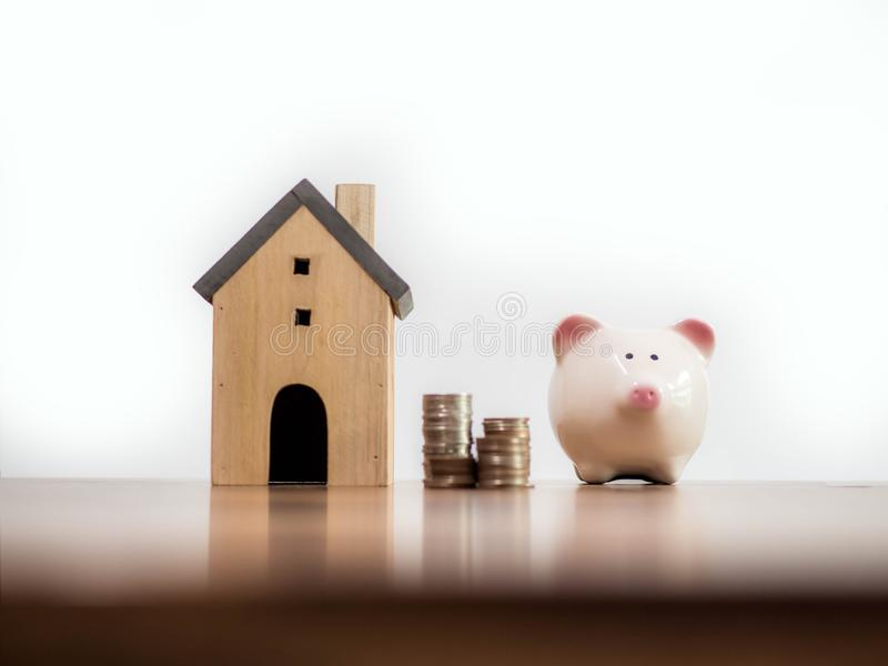 Household savings and finances, Model house money and piggy bank. Saving money concept stock photo