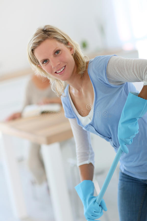 Housekeeper cleaning the floor royalty free stock photography
