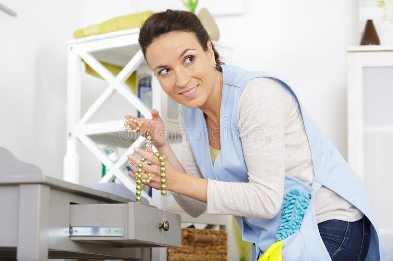 Housekeeper going to steal set necklaces royalty free stock images