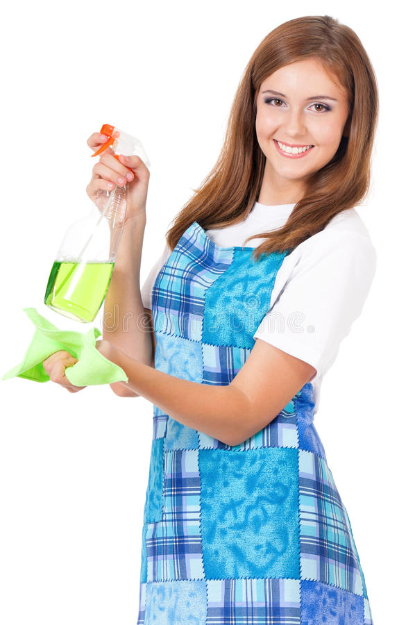 Housekeeper isolated portrait. Smiling young woman holding bottle of chemistry for cleaning house. Beautiful happy girl with microfiber cloth and cleaning spray royalty free stock photography