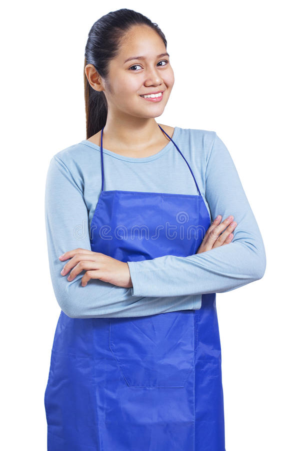 Housekeeper. Portrait of a happy and smiling young housekeeper. Isolated in white background royalty free stock photography