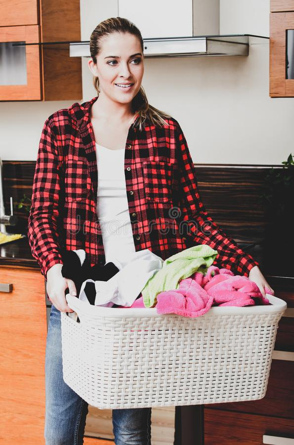 Housekeeper woman with laundry royalty free stock images