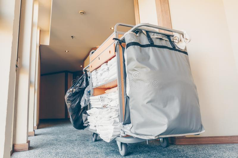 Housekeeping cart in the hotel corridor. Horizontal, light blue toning royalty free stock images