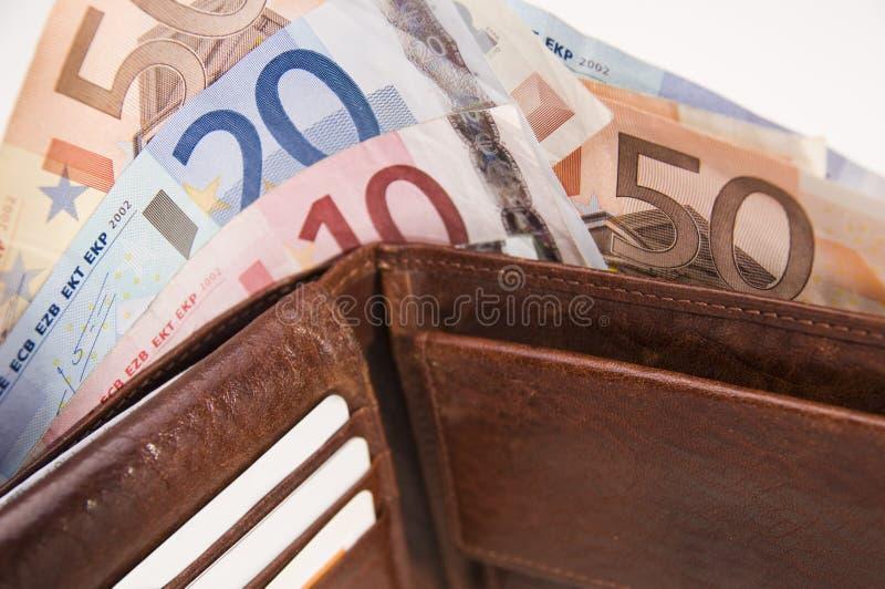 Housekeeping money. Purse with euro notes on white background stock photos